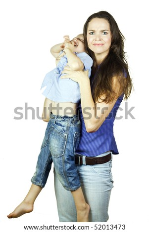 A young mother holding a screaming and squirming toddler