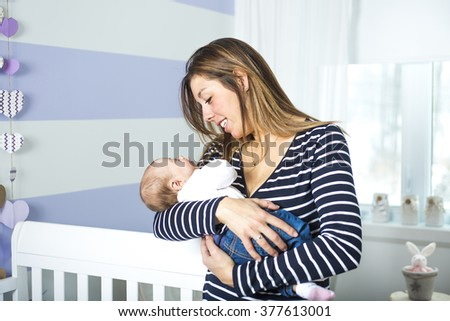 A young mother with a charming baby - stock photo