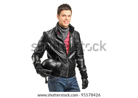 A young motorcycler holding a helmet posing isolated on white background - stock photo