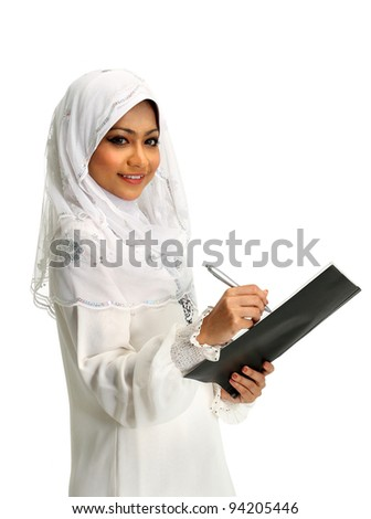 A young muslim girl writing on report file, isolated on white background - stock photo