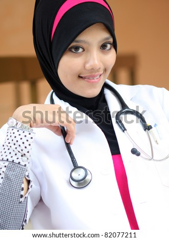 A young muslim woman doctor smiling - stock photo
