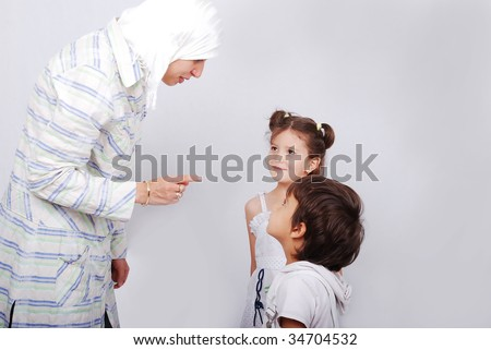 A young muslim woman in traditional clothes in education process - stock photo