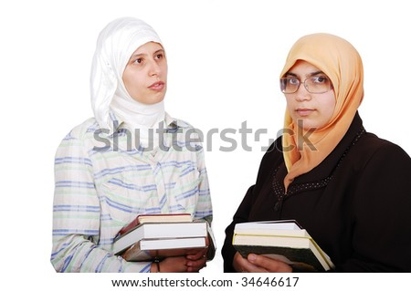 A young muslim women in traditional clothes in education process - stock photo