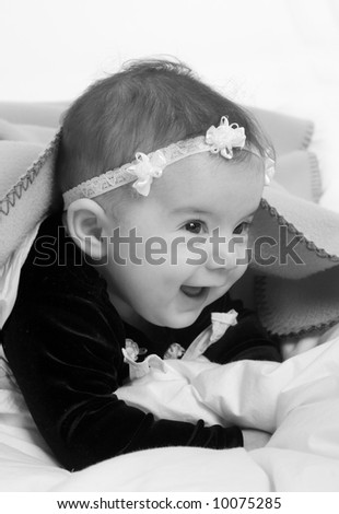A young newborn baby girl with a cute smile - stock photo