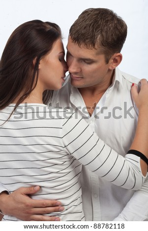 a young passionate couple embracing each other - stock photo