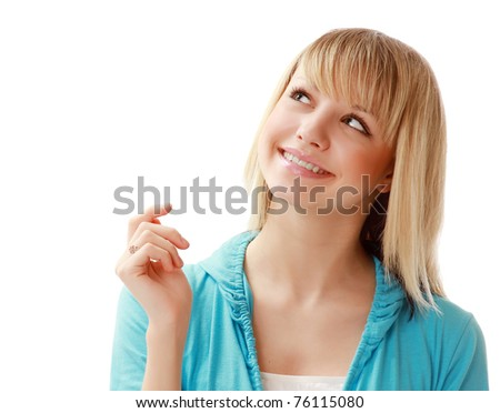 A young pensive girl looking up - stock photo