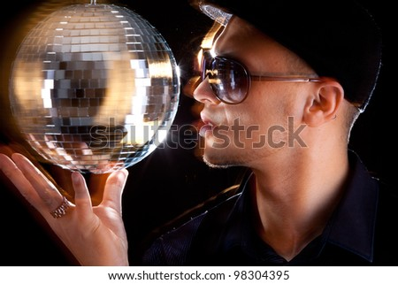 A young philippino playing with a disco ball - stock photo