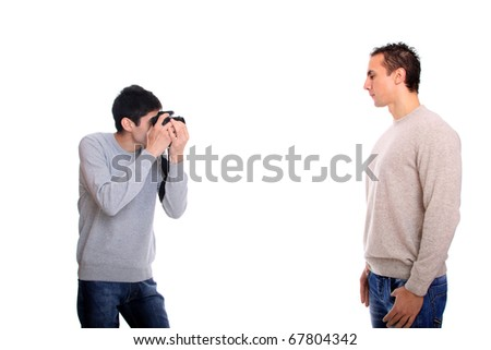 A young photographer taking a photo of a model with DSLR camera - stock photo