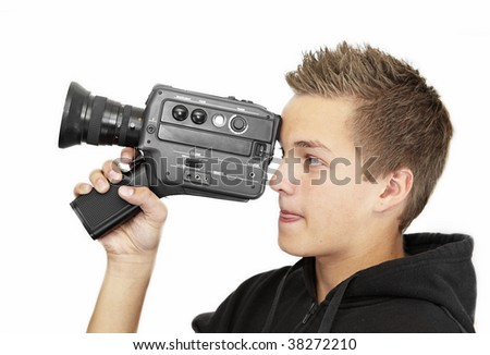 A young photographer with a 8mm camera - stock photo