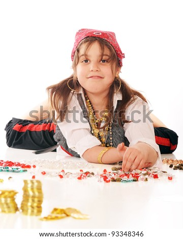 A young pirate girl counting her multitude of jewels and gold coins.  On a white background. - stock photo