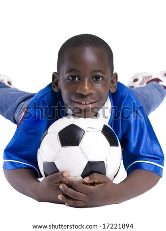 A young preteen with his favorite thing... Soccer - stock photo