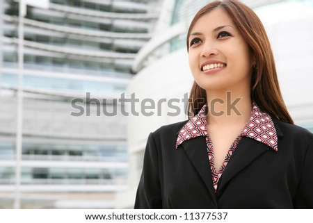 A young pretty asian business woman at her company - stock photo