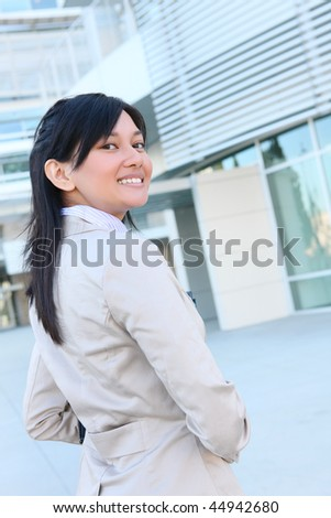 A young pretty asian business woman at office building - stock photo