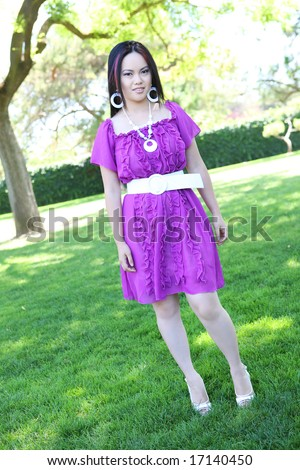 A young, pretty asian woman in the park