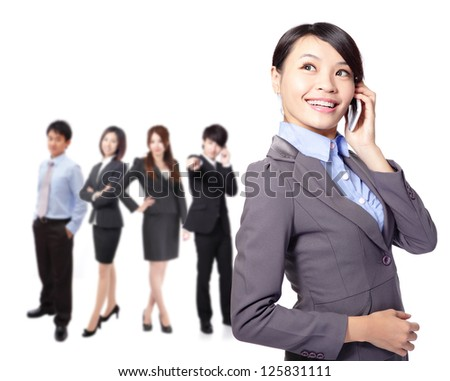 A young pretty asian woman on the phone with team in background isolated on white background, asian people - stock photo