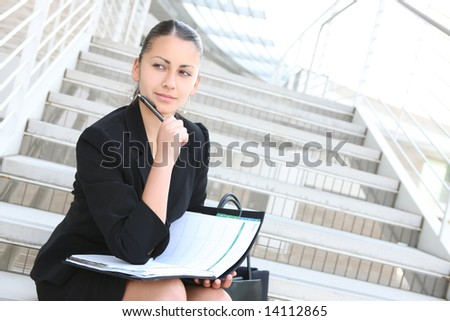 A young, pretty business woman outside an office building