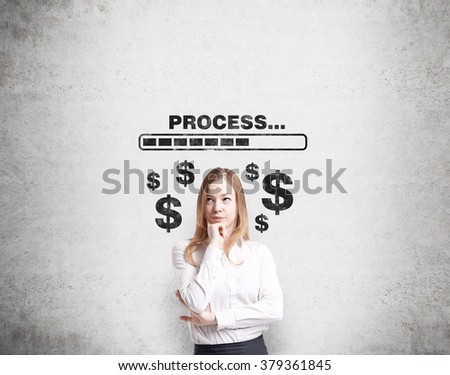 A young pretty businesswoman with hand to the chin thinking about earning money, the word 'processing' and dollar signs painted over her. Concrete background. Concept of earning money - stock photo