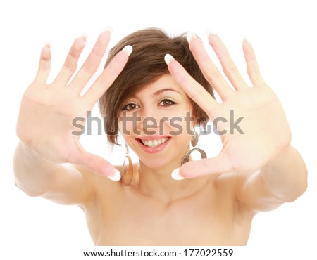 A young pretty girl framing her face with her hands - stock photo