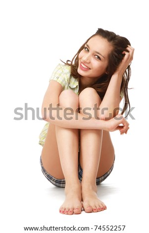 A young pretty girl sitting on the floor