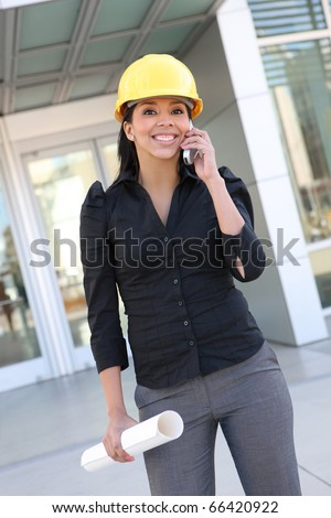 A young pretty hispanic woman architect with at building work site