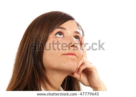 A young, pretty woman looks thoughtfully up - space for text - stock photo