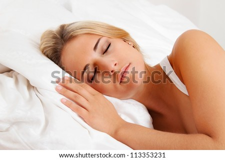 a young pretty woman sleeping in bed and recover. - stock photo