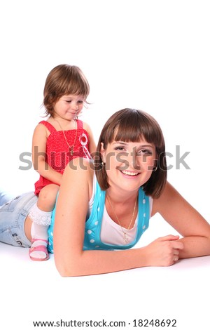 A young pretty woman with a little girl sitting on her back over white background