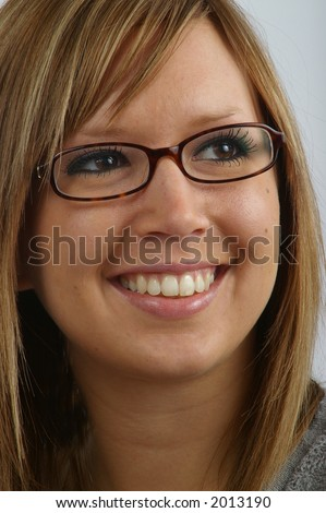 A young professional lifts her gaze upward toward a bright future. - stock photo