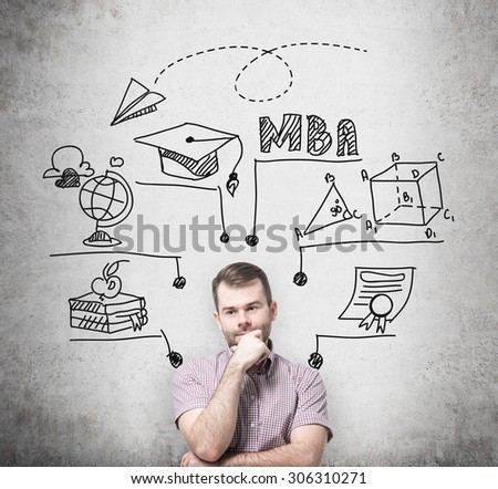 A young prosperous man is thinking about MBA degree. Educational chart is drawn behind him. A concept of further business education. Concrete background. - stock photo