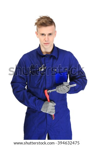 A young repairman holding car repairing tool, on white background - stock photo