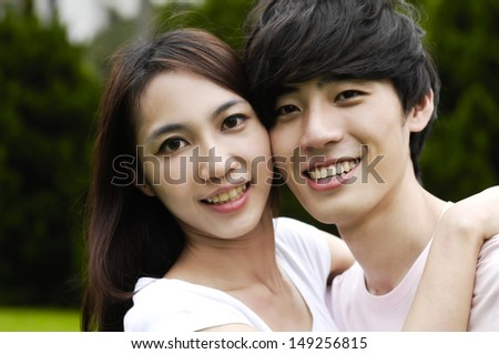 a young romantic couple embracing each other - stock photo