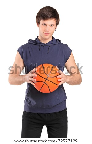 A young school boy holding a basketball isolated on white background - stock photo