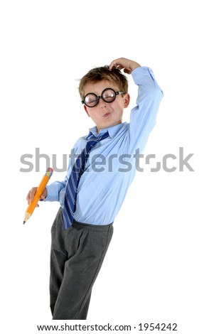 A young school boy in comical nerd glasses scratches his head