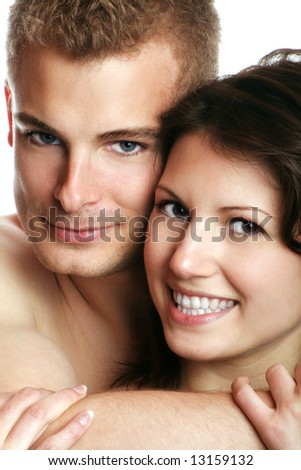 a young sexy couple is smiling isolated on white background