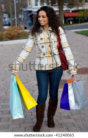 A young shopaholic out shopping in the city. - stock photo