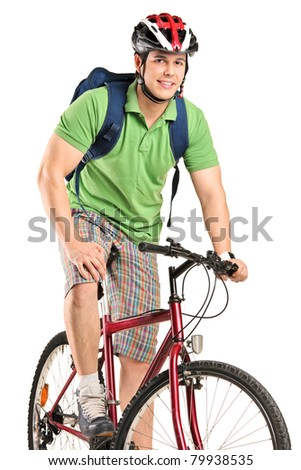 A young smiling bicyclist posing on a bicycle isolated on white background - stock photo