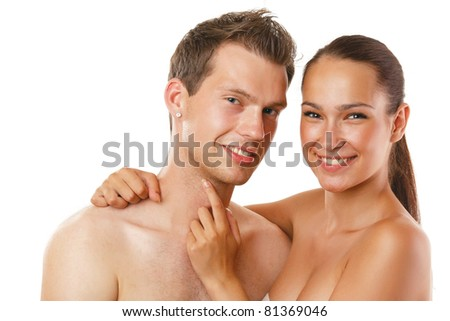 A young smiling couple isolated on white background - stock photo