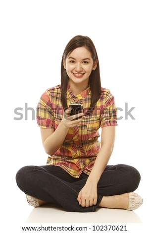 A young smiling woman with a mobile phone (on white)