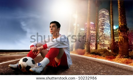 a young soccer player on the american street - stock photo