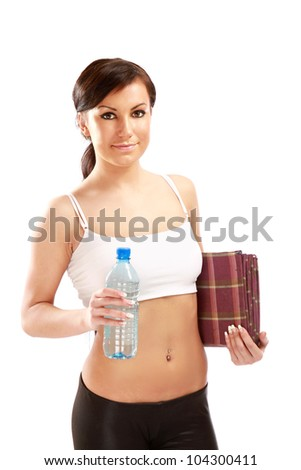 A young sportive girl with a bottle of water and a mat