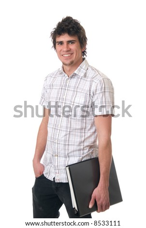 A young student holding a binder in his arm