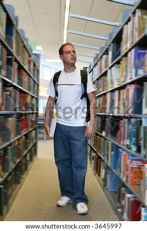 A young student in the library looking for books