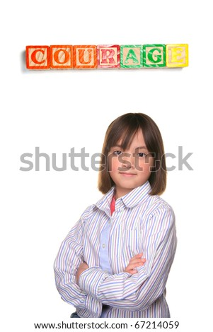 A young student showing couragous pose under word blocks. - stock photo