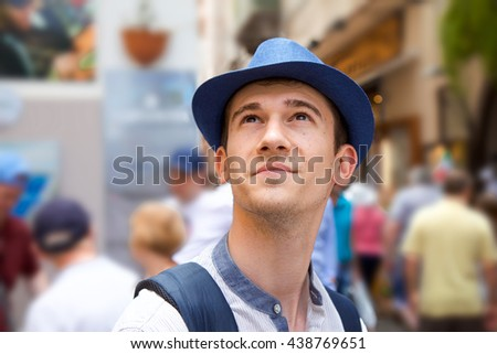A young student wearing casual clothes and a hat and sunglasses enjoying his vacation in Europe on Amalfi coast in summer. - stock photo
