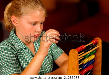 A young student working on her abacus - stock photo