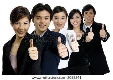 A young successful asian business team gives the thumbs up on white background - stock photo