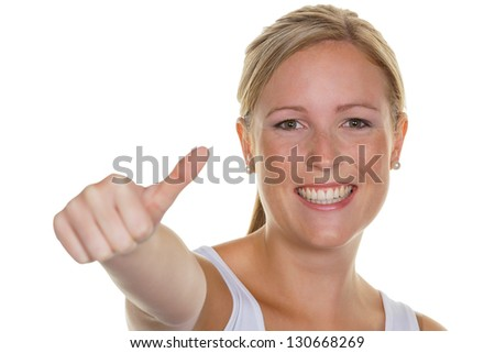 a young, successful woman holds his thumb up. symbol for success, exempted white background - stock photo
