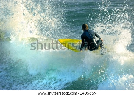 A young surfer boy cuts back on a gorgeous Southern California wave. - stock photo
