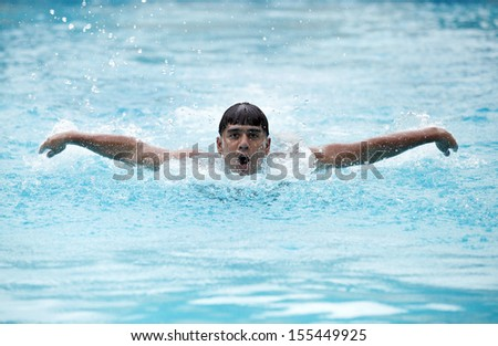 A young swimmer performing butterfly stroke