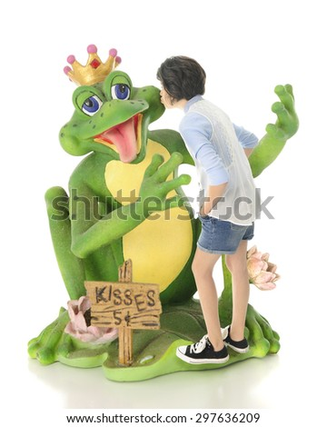 A young teen girl kissing a delighted frog prince.  The price ...only five cents!  On a white background. - stock photo